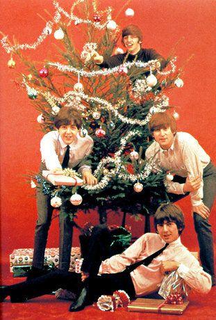 Photo of BEATLES; The Beatles at Christmas, clockwise from left - Paul McCartney, Ringo Starr, John Lennon and George Harrison