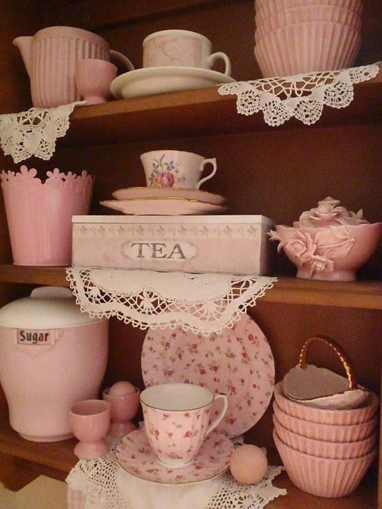 Lovely shelf of pink china, pottery, lace