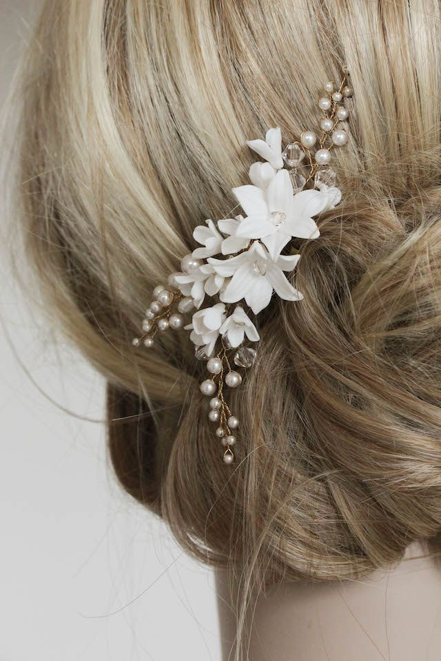 If you're a flower lover and you'd love to have some florals in your hair, perhaps a floral bridal pin is the perfect piece to finish your hairstyle.