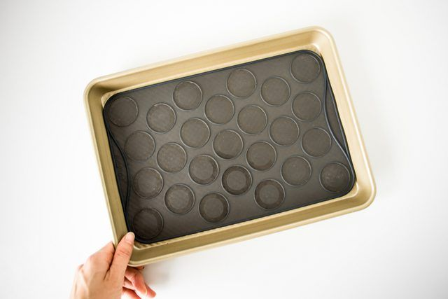 Prepare a baking tray with either baking parchment or a silicone macaron slip-mat,