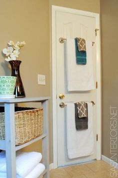 Use the back of a bathroom door to hang towels! | 29 Sneaky Tips For Small Space Living | Organize your home | Tips, tricks and easy DIY ideas for storage