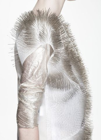 Fashion Meets Art: technology driven couture - wearable pin sculpture; interactive clothing that responds to sounds, voice and human presence // Ying Gao at the Fashion X Technology show