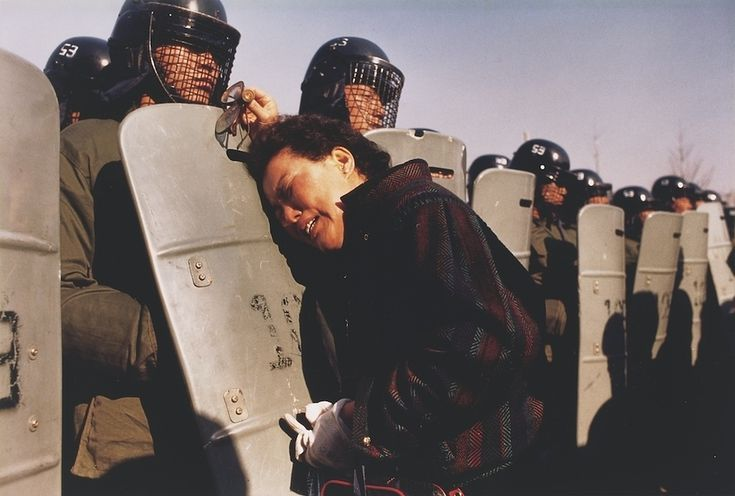 1987 - A mother clings to a riot policeman's shield at a polling station. Her son was one of thousands of demonstrators arrested because they tried to prove that the presidential election on December 15, which was won by the government candidate, had been rigged. (Anthony Suau)