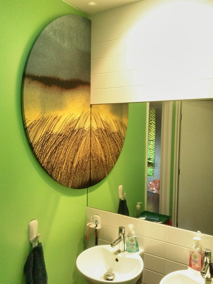 Semi-circle frame, mounted fabric from Marrimeko.   Mounted on wall next to a mirror.   Love everything from Marrimeko, Finland
