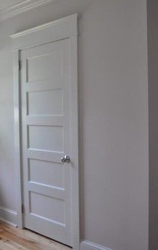 Craftsman look for interior doors traditional interior doors.  High door casing. ElongTes door & creates height.