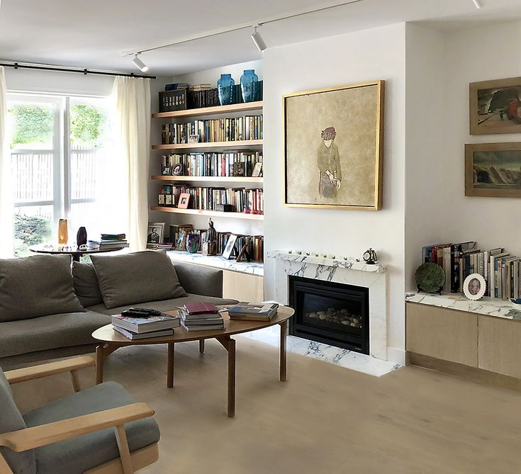 malvern house defined by a  sophisticated material palette of pale timbers, veined marble and striking deep blue cabinetry
