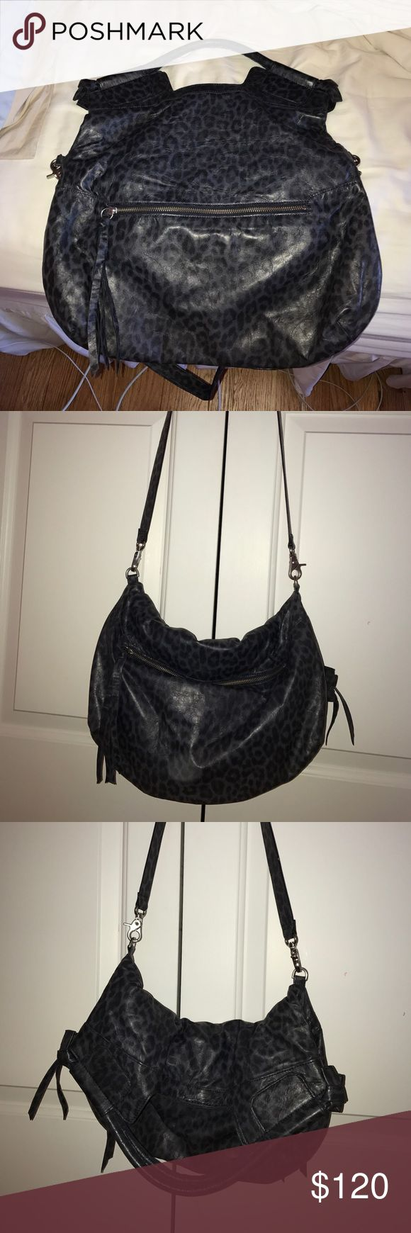 Foley + Corinna animal print bag. ONLY USED ONCE Large navy blue and black animal print bag. Can be worn with long strap or folds over to make it smaller and can carry with hand. Zipper on each side of bag. Can take strap off bag. Foley + Corinna Bags