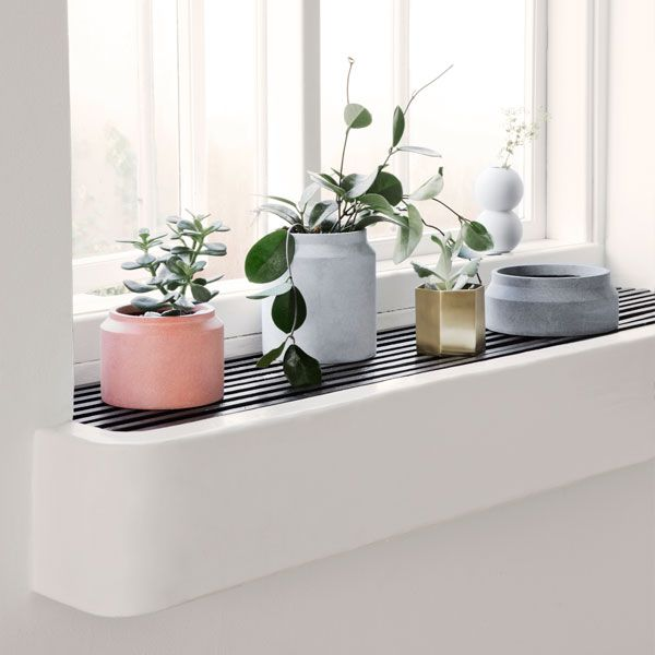Ferm Living's minimalistic pots are made of concrete and come in three earthy hues. Combine different sized pots and create attractive groups of plants and flowers on windowsills, balconies and terraces.
