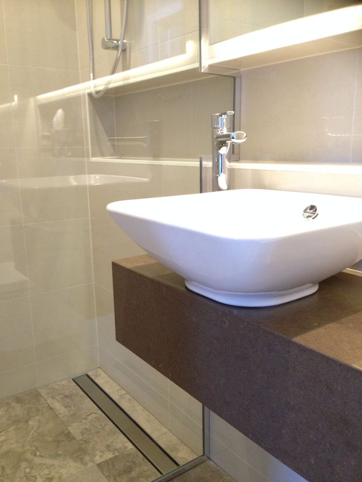 The use of LED strip lights adds extra sparkle to this ensuite bathroom.