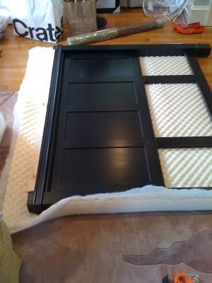 "She took a plain wooden headboard ""and then wrapped it all up with an egg crate mattress pad (cheapest foam out there!) and batting and some peacock blue velvet and stapled everything into place."" for an upholstered one."