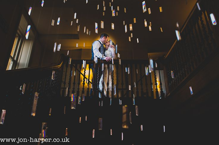 Stunning shot taken looking through the crystals of the chandelier at Cowley Manor.  I love how it frames my couple and adds a bit of magic.