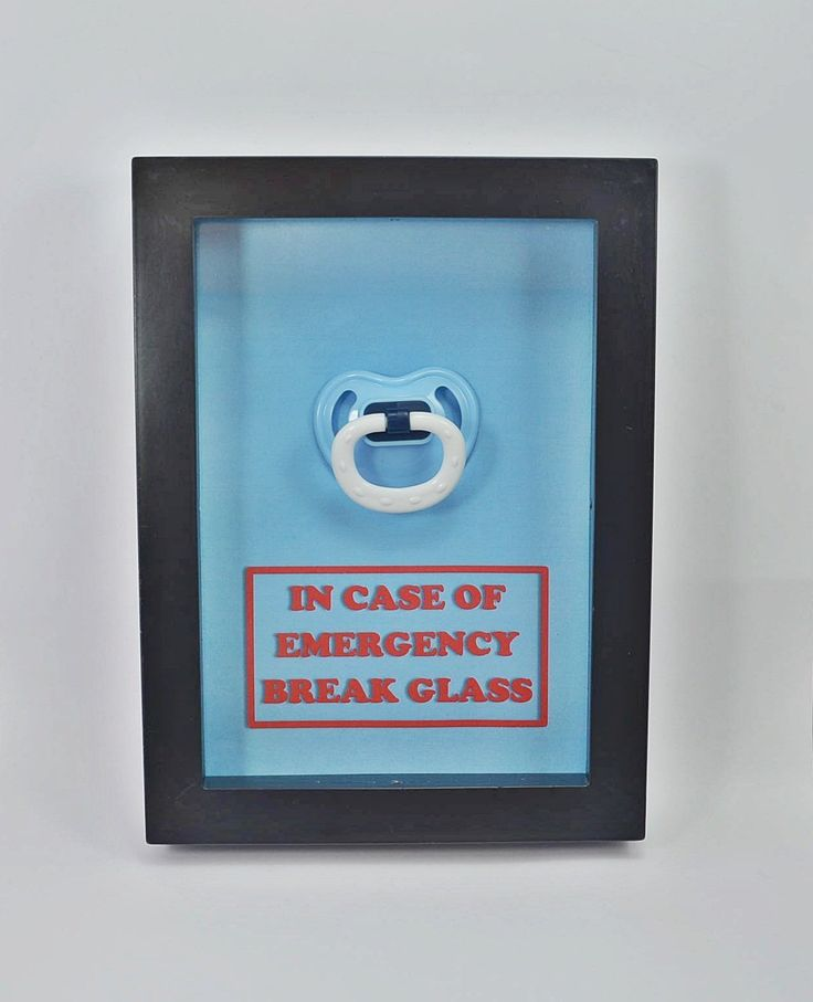 "In Case of Emergency Break Glass - Baby Shower Gift - Pacifier - Emergency Kit - Gift for New Mom, Gift for New Parents, Gift for New Born, Gift for New Mother, Nursery Decor. ✿ The shadow box contains a real pacifier (random color) and a ""In case of Emergency Break Glass"" sign printed on the background. ✿ Box Dimension: 5"" x 7"" (Inside) 6"" x 8"" (Outside). The box has a depth of 0.75"". ✿ And the box can easily be opened from the back ✿ Tracking number will be provided once the order is..."