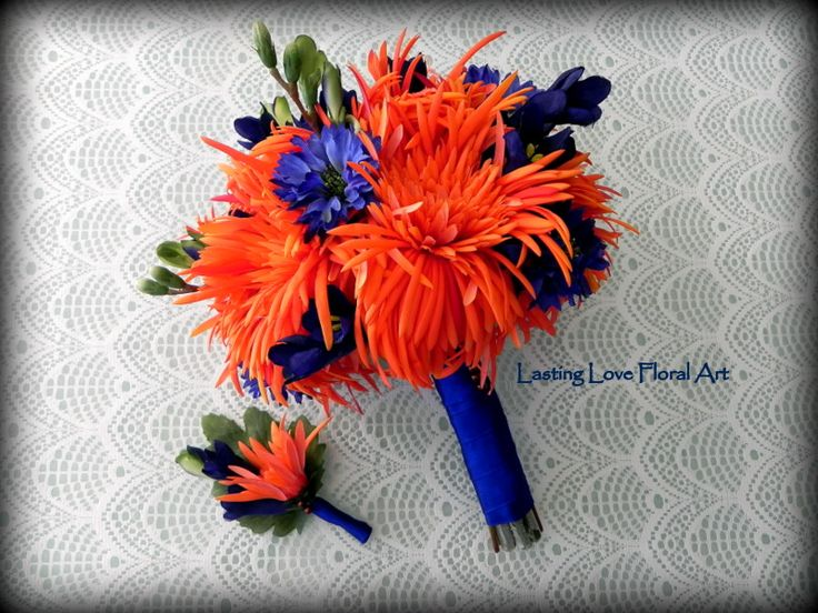 Orange real touch mums and silks in blue make this stunning bouquet and boutonniere pop!  #blueandorangewedding #blueandorangeweddingflowers #orangeandbluewedding #orangeandblueweddingflowers #orangeandbluebouquet #blueandorangebouquet #orangewedding #bluewedding #weddingflowers