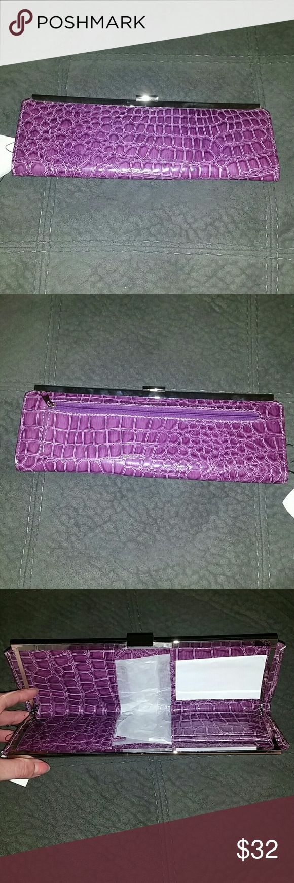 NWT!! Gorgeous purple clutch!! This is NEW with original tags!! This is a very long one measuring 12x4!! Bags Clutches & Wristlets