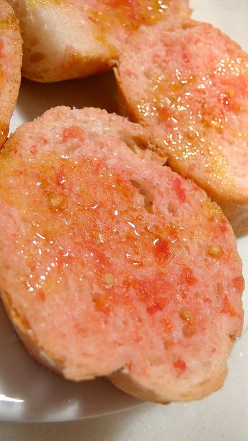 """Pa amb tomàquet. Literally in English: """"Bread with tomato"""". It's a simple and typical recipe in Catalonia. It consists of bread — optionally toasted — with tomato rubbed over and seasoned with olive oil and salt. Sometimes garlic is rubbed on the bread before rubbing in the tomato."""