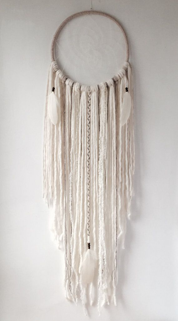 No more nightmares! Only good dreams would be allowed to filter through this beautiful boho dreamcatcher... Bad dreams would stay in the net, disappearing with the light of day.  Dreamcatcher entirely made by hand with pure natural materials, as such each product might vary slightly.