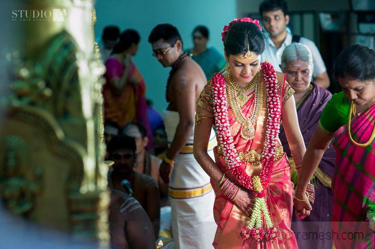 South Indian bride. Temple Indian bridal jewelry. Jhumkis.Classic red kanchipuram sari.Braid with fresh jasmine flowers. Tamil bride. Telugu bride. Kannada bride. Hindu bride. Malayalee bride.Kerala bride.South Indian wedding