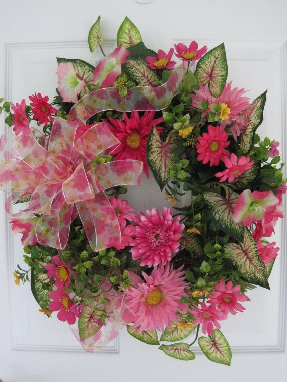 shades of pink, buttercup, gerbera daisies and mixed wildflowers with a touch of yellow, caladium leaves with deep pink veins and flowering boxwood, floral print ribbon