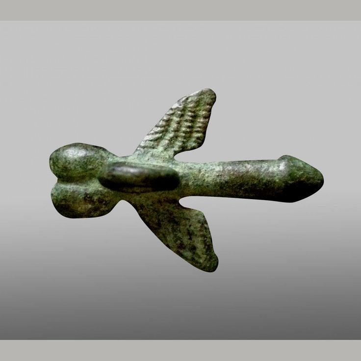 A stunning cast bronze phallus with suspension loop to the rear, wings to each side. — app.antiquitiesinc.com