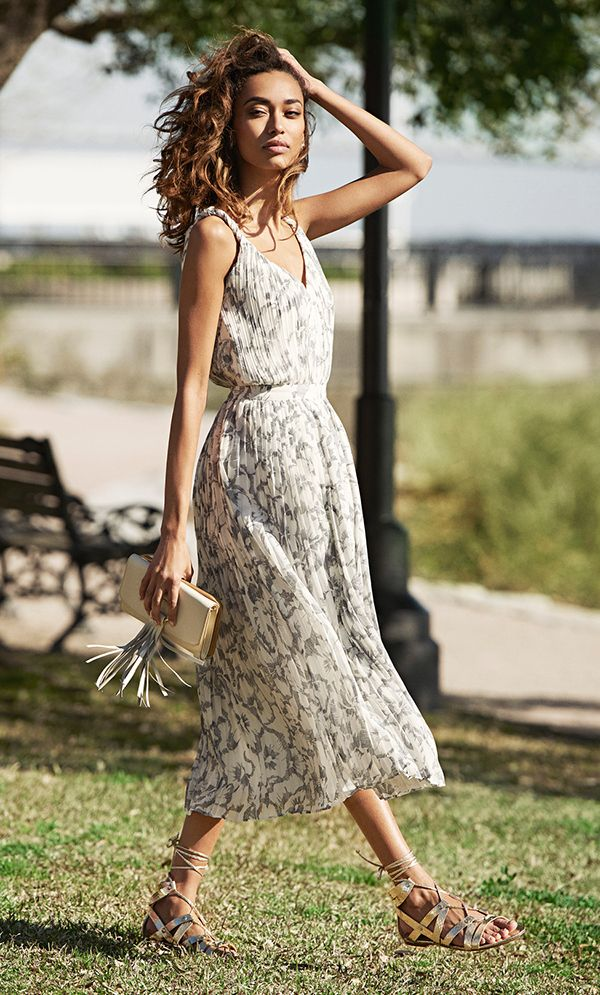 Modern floral with a timelessly chic pleated twist. Our figure flattering midi length dress is the most versatile piece to wear this summer. Pair this frock with a lightweight cardigan for an office ready look or accessorize your look with a leather clutch and gold sandal for the perfect date night look | Banana Republic