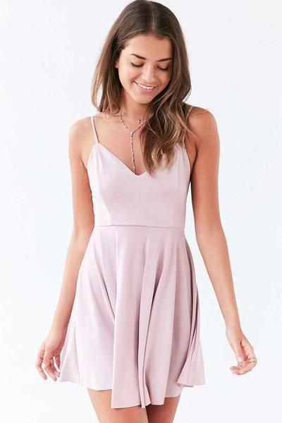 Effortless sleeveless crepe jersey dress with a strappy plunging back by…
