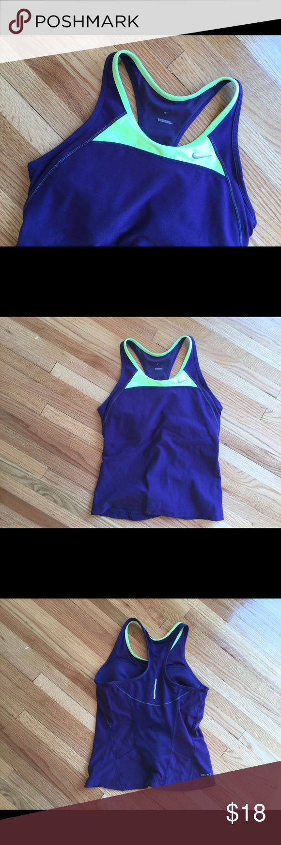 Nike running tank top Purple with neon yellow trim. Built in bra. Sizing has rubbed off at the top but the tag inside at the bottom says medium. Mesh material at the neckline in the back for breathability. Pockets near the bottom of the shirt in the back! Nike Tops