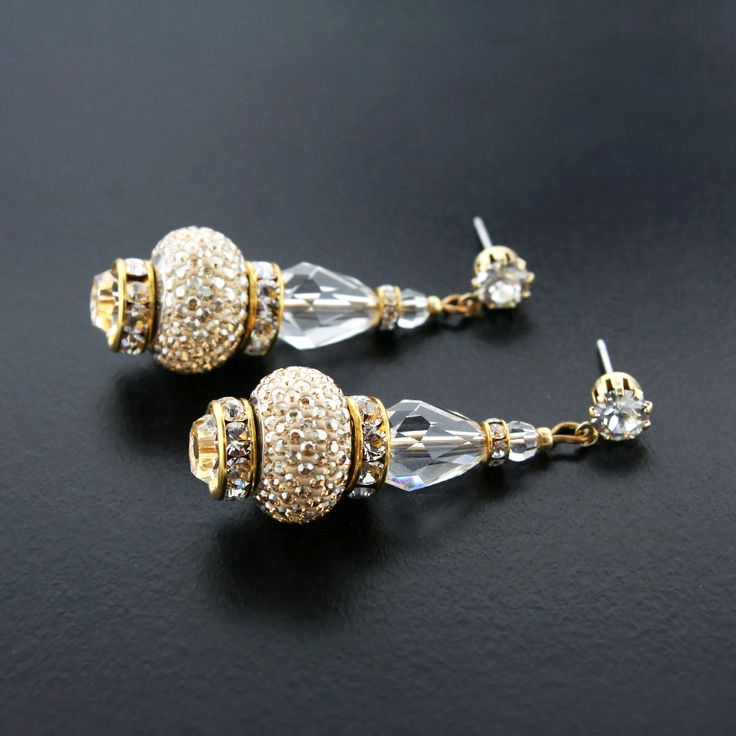 """These dazzling drop earrings are made with Swarovski® crystals and charms.  Shown here in gold, also available in silver. 1.75"""" long. Made in USA. Style HOL582E."""