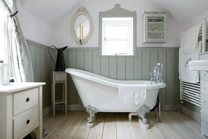 Beautiful Panelling Style from The English Panelling Co. Love the pale green-blue paint colour and what a great roll top bath! Can see myself relaxing in this for hours!  If you like this pin, why not head on over to get similar inspiration and join our FREE home design resource library at http://www.TheHomeDesignSchool.com/signup