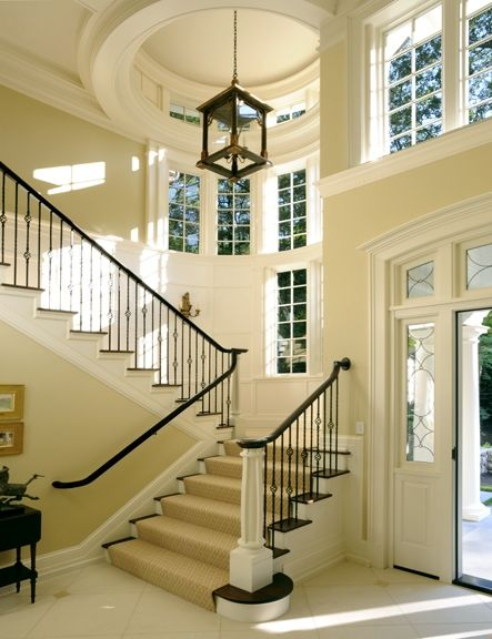 Entry way. High ceiling, spacious, tall windows, wide staircase. Absolutely want this for my house.: Dreams Houses, Idea, Stairs, Lights Fixtures, High Ceilings, Natural Lights, Window Seats, Design, Entryway
