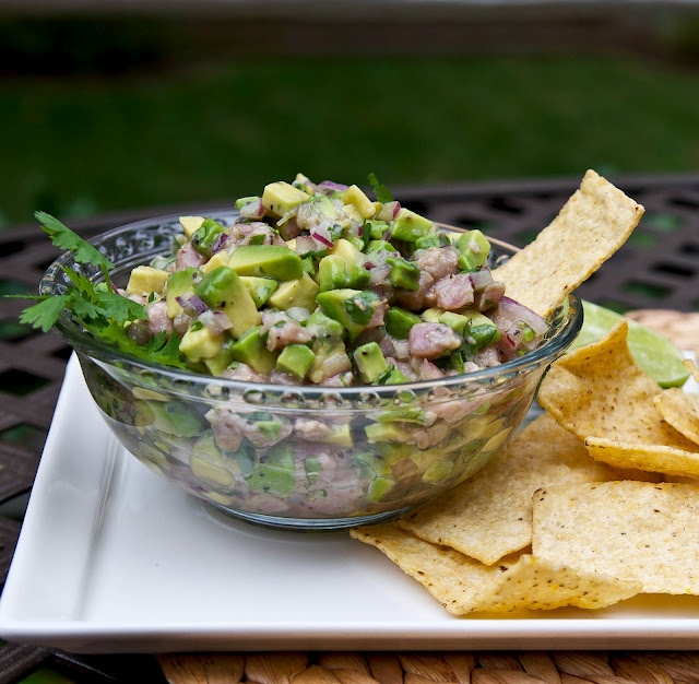 Tuna Ceviche with Avocado    1 lb Sushi grade tuna  1 sm red onion sliced  3/4 cup fresh lime juice  1 tsp freshly grd black pepper  1 lg Hass avocado, cut into 1/3 inch dice  1/4 cup coarsely chopped cilantro  salt