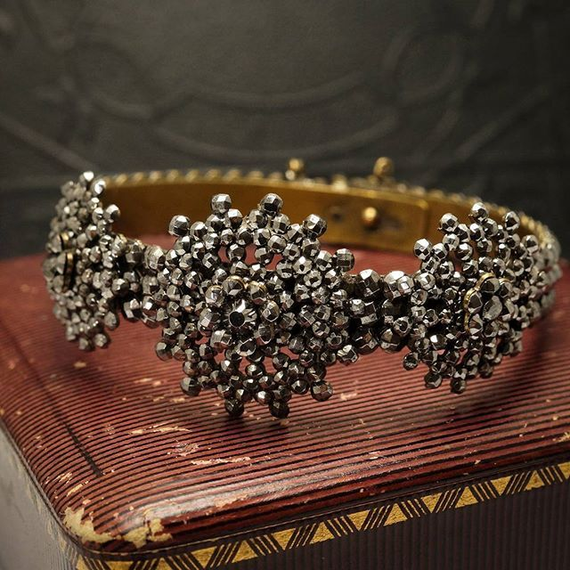 This #Victorian bangle has the moody high-wattage sparkle only cut steel jewelry can deliver. The three mandala-shaped clusters are riveted to a copper base, and the bracelet features an interior closure and safety chain.