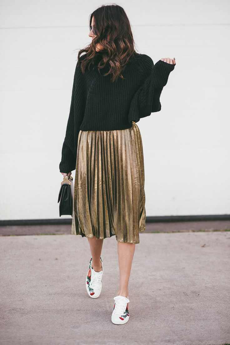 Black sweater and gold pleated skirt