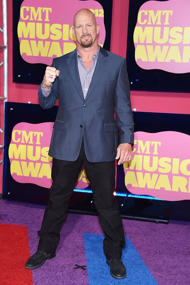 """Former WWE wrestler """"Stone Cold"""" Steve Austin put on not just a shirt, but an entire suit for the 2012 CMT Music Awards.  After all, Austin, who's now the host of CMT's reality competition """"Redneck Island,"""" was a presenter."""