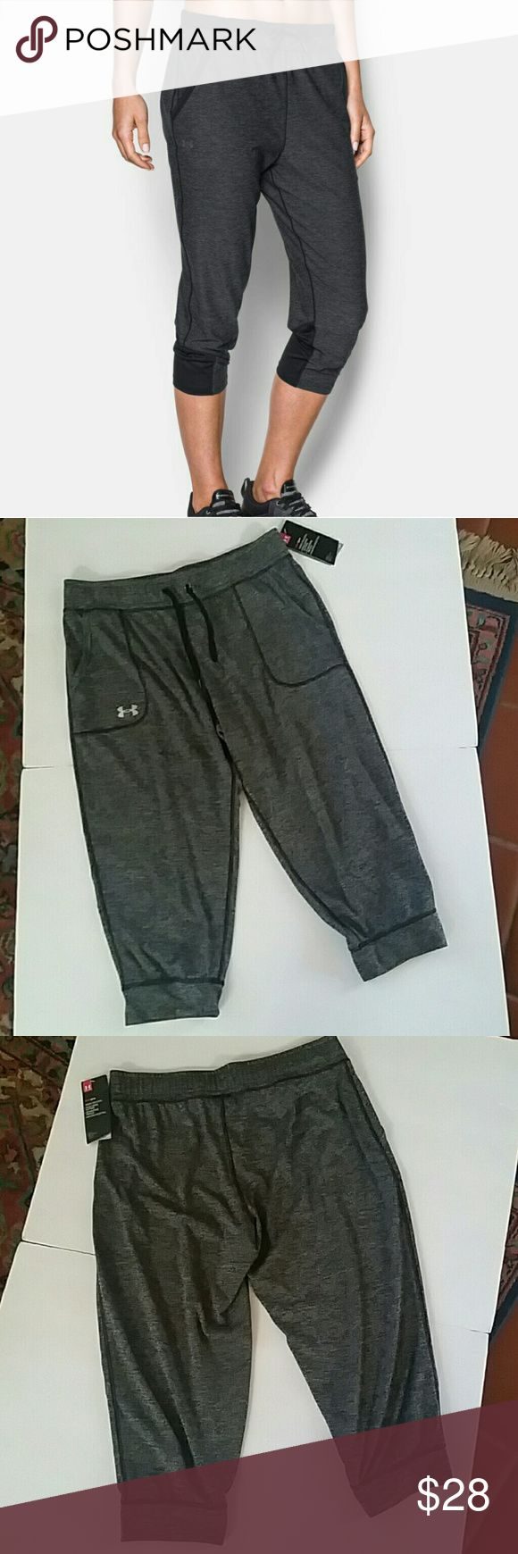 "Women's Under Armour Jogger Pants Loose: Generous, more relaxed fit. Material wicks sweat & dries really fast Super-breathable mesh hem panels for superior ventilation Soft & stretchy covered elastic waistband with drawcord & binding detail Open hand pockets Inseam: 20"" 100% Polyester *Covershot is the same item but NOT the same color.  See pics #2 & #3 for exact color of item.  **Price firm unless bundled Under Armour Pants Track Pants & Joggers"