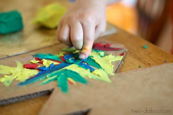 Use plasticine clay to create colorful art- a perfect toddler art technique!