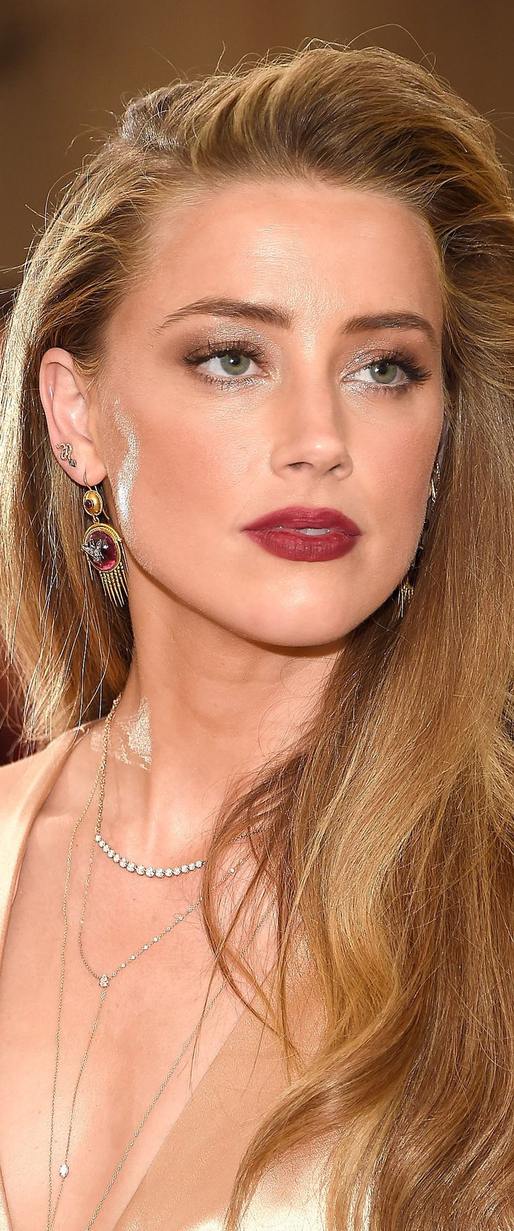 Shimmery eye makeup and berry color lips                                                                                                                                                                                 More
