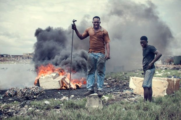 Adam Nasara, 25, uses Styropor, an insulating material from refrigerators, to light a fire