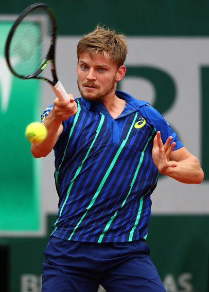 David Goffin Photos - David Goffin of Belgium hits a forehand during the Men's Singles quarter final match against Dominic Thiem of Austria on day twelve of the 2016 French Open at Roland Garros on June 2, 2016 in Paris, France. - 2016 French Open - Day Twelve