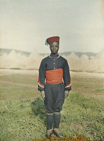 Senegales sniper in Fez, Morocco, 1913, Stéphane Passet, public domain via Wikimedia Commons.