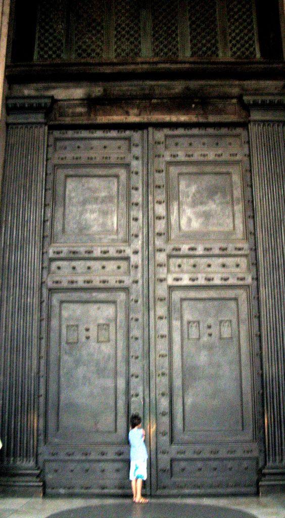 The 7 meters high bronze door of the Pantheon. Some historians believe that this is the original door.