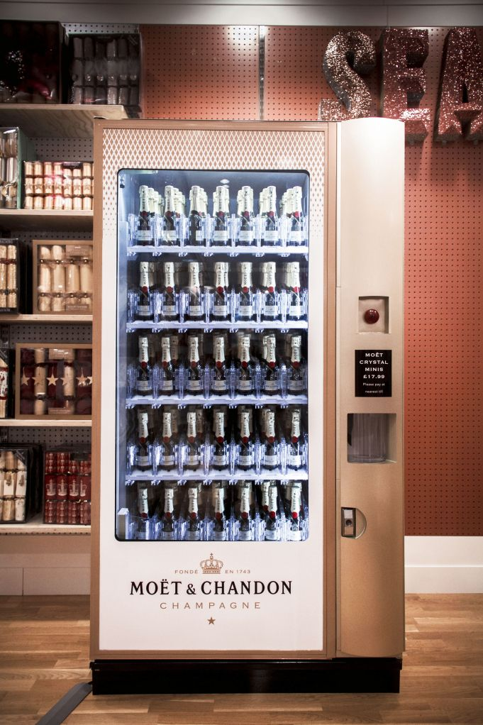 Moet & Chandon vending machine stocked with mini champagne bottles in Selfridges department store on  Oxford Street