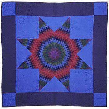 Lone Star. Laine et batiste de laine. Lancaster County, Pennsylvanie. 214 cm x 237 cm Confectionné en 1990 par Katie Esh, alors âgée de 79 ans et dont ce fut le dernier quilt.