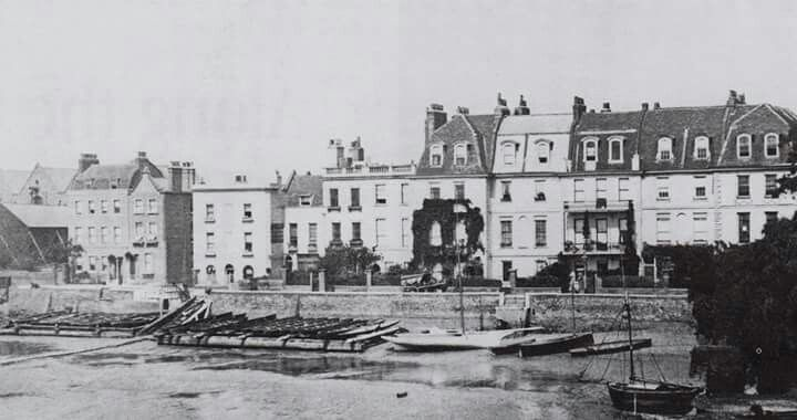 ...CHEYNE WALK 1890       ....Houses fringing the river, built in 1708. Boats squat in the mud under the embankment...