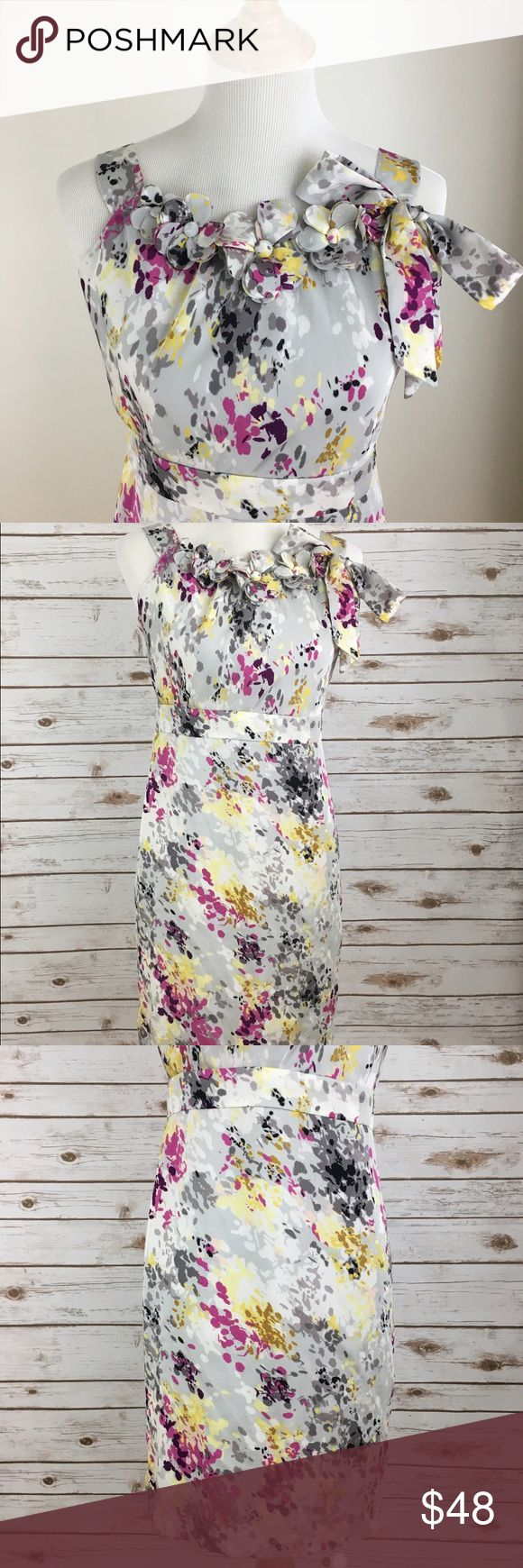 "Ann Taylor Loft Floral Summer Dress Ann Taylor Loft sleeveless dress. Beautiful dress with fabric flowers at neckline and bow on left side strap. Defined waist. Fully lined. Zip back. Size 6. Gently used, no flaws. Please see pictures for details.  armpit to armpit - 17"" shoulder to waist - 14: waist to hem - 20"" Ann Taylor Factory Dresses"
