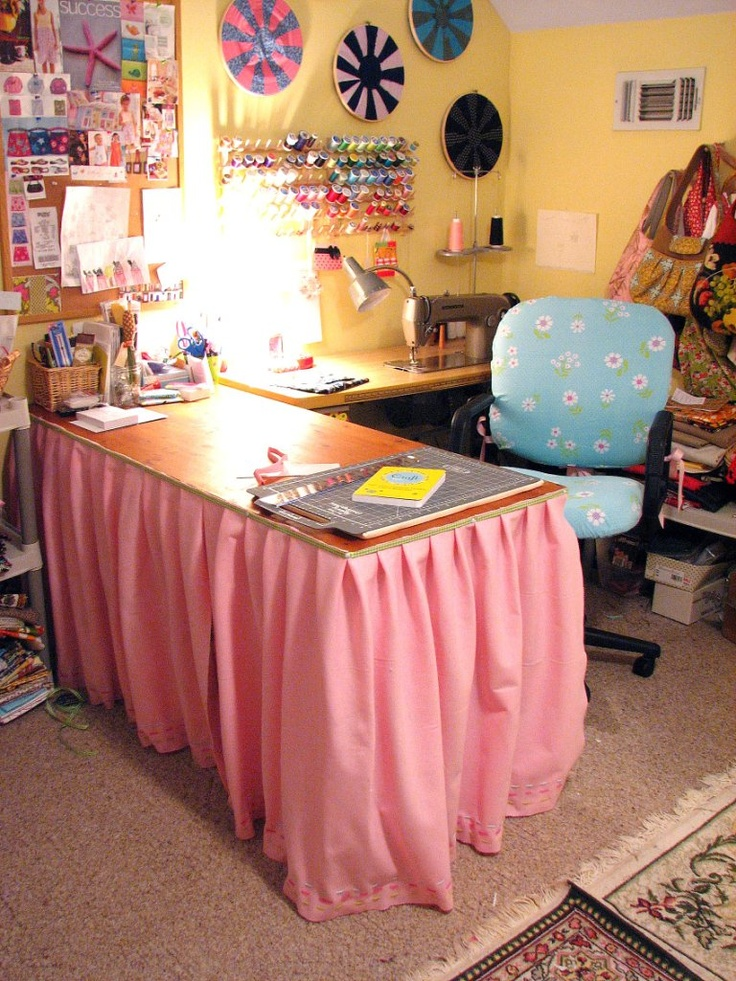 sewing room table cloth over cheap table cutting board on top