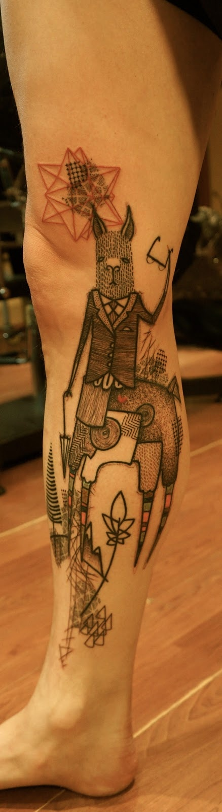 Lauren Mmmmmmm's husband Eric's new llama tattoo by Noon