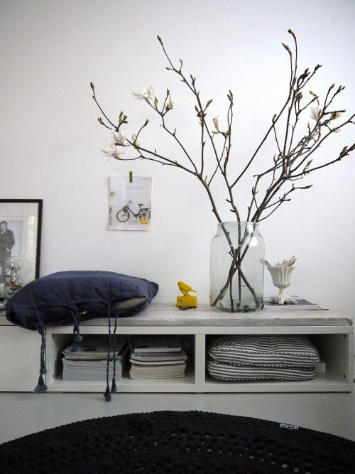 round hooked carpet fromDesign lemonade; huge vase fromconcept storeOptions in Amsterdam / branches! grey! picture taped to white wall!