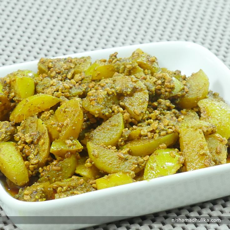 Amla methi achar or gooseberry fenugreek pickle is tasty as well as nutritious pickle.  Recipe in English - http://indiangoodfood.com/1172-amla-methi-dana-pickle.html (copy and paste link into browser)