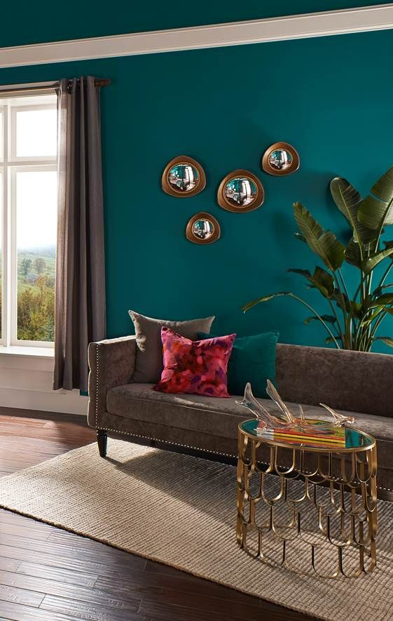 A rich teal hue of Behr Premium Plus Ultra coats the walls and ceiling in this luxe master bedroom seating area. Get more teal paint inspiration. & A rich teal hue of Behr Premium Plus Ultra coats the walls and ...