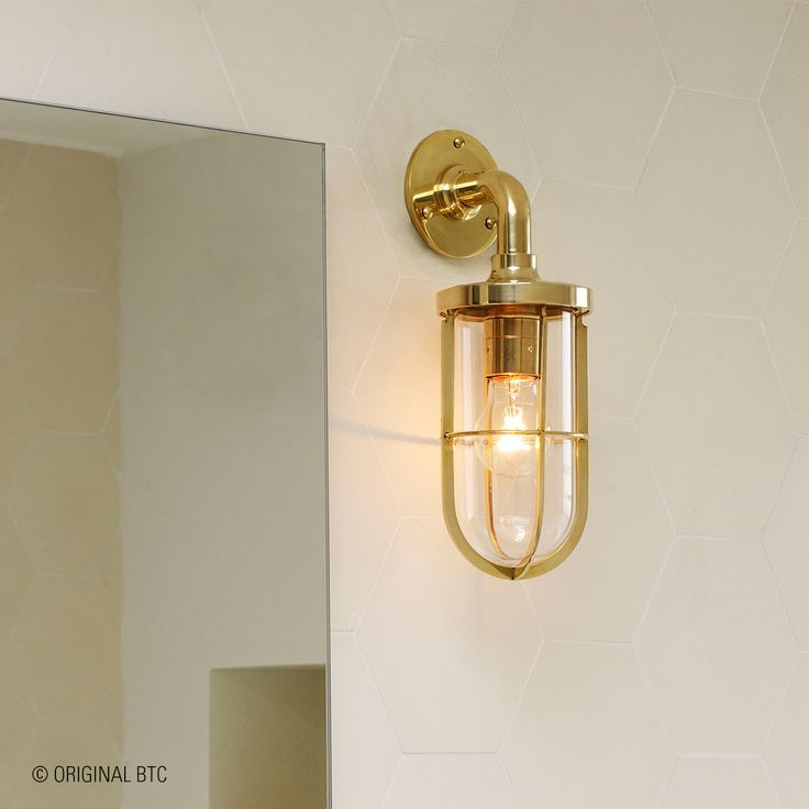 Davey Lighting's Weatherproof Ship's Well Glass Light helps you create a coastal feel to your bathroom. #DaveyLighting #OriginalBTC #lightingdesigns #coastal #bathroomlighting #outdoorlighting #interiordesign